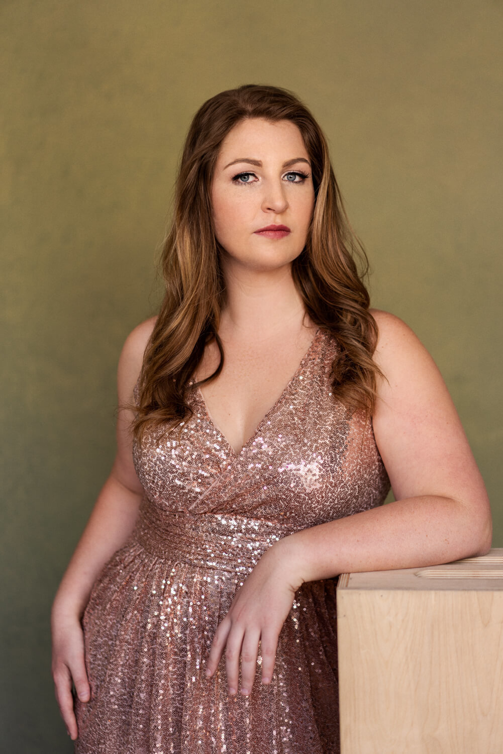 Portrait posing on applebox with glittery glamour dress