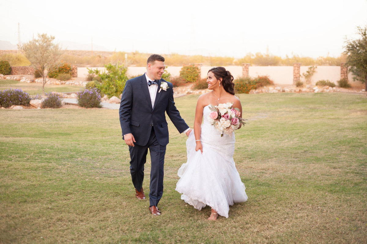 bride and groom walking sunset