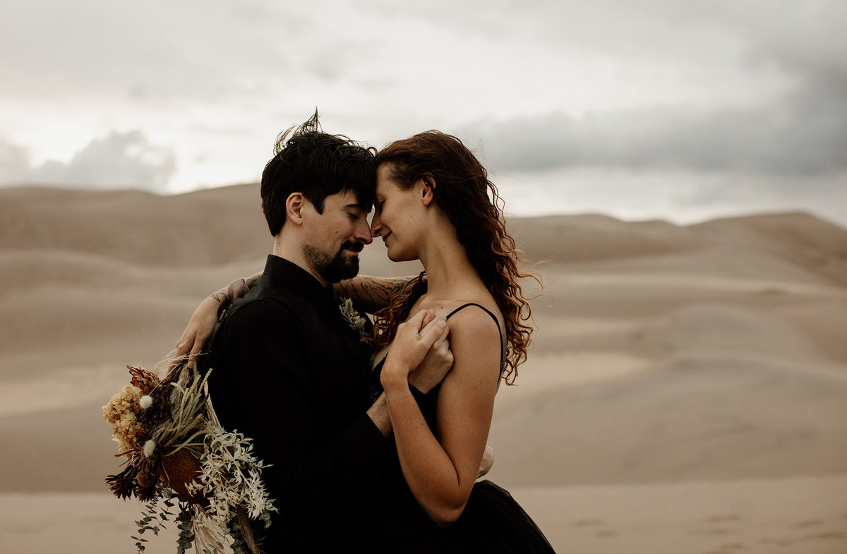 Desert Elopement editorial - romantic and moody sand dunes shoot