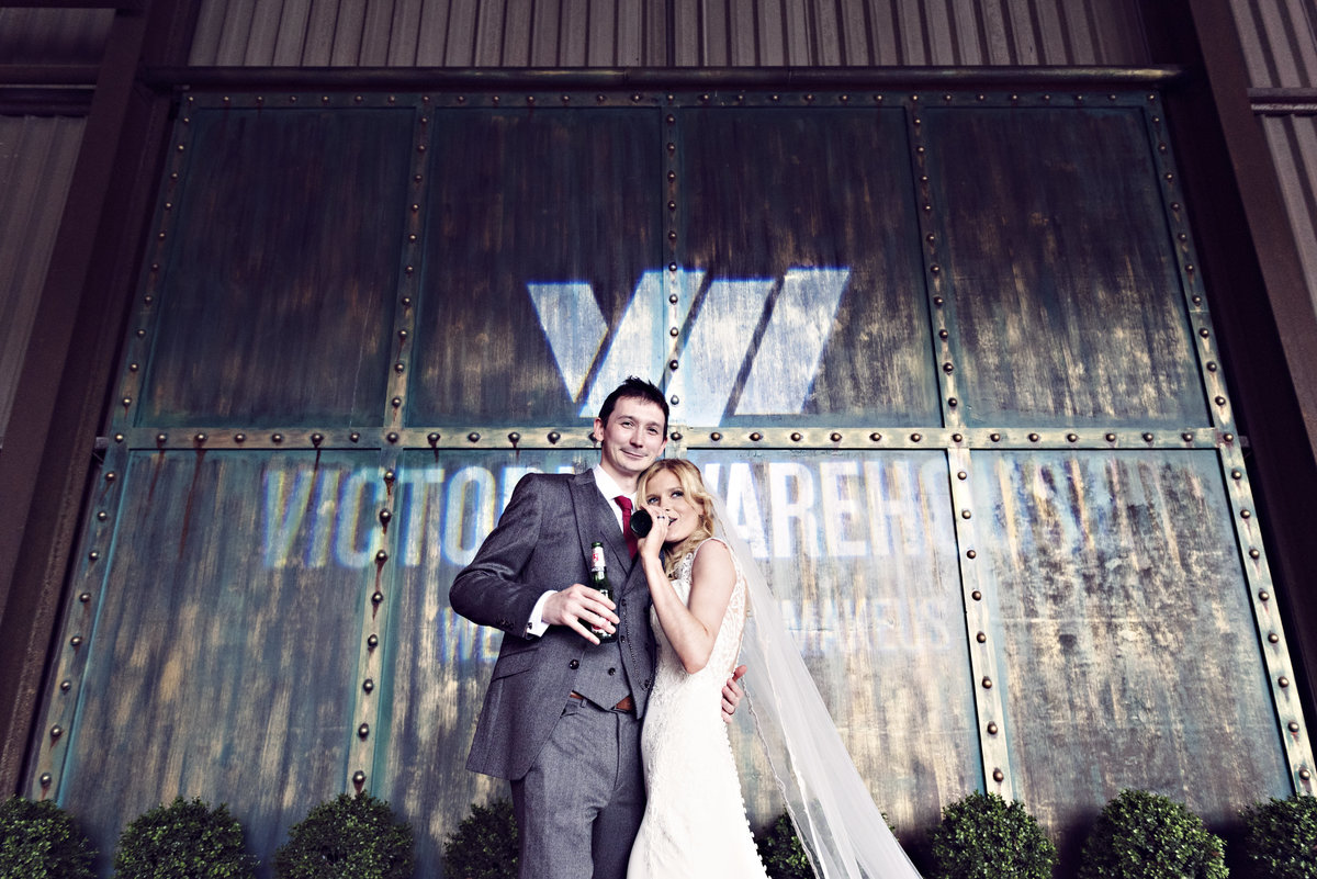 A bride and groom enjoying a beer at Victoria Warehouse Manchester City