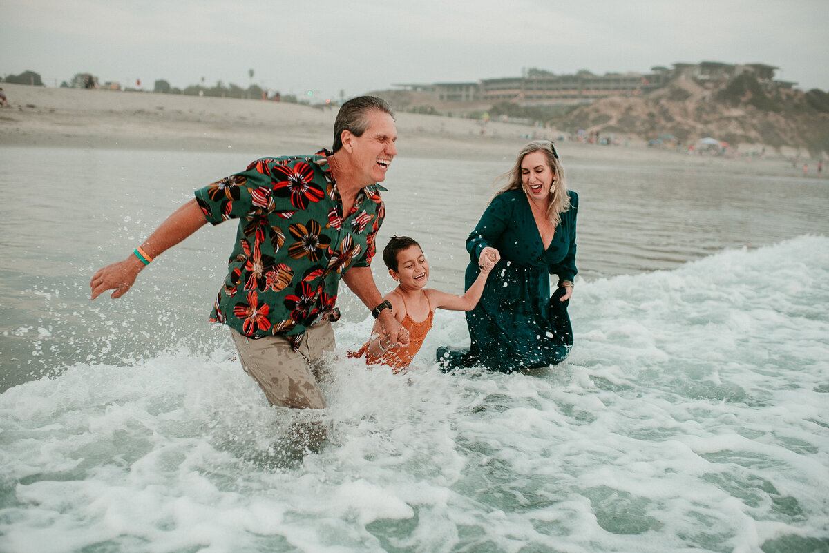 Carlsbad Family Photographer-jump the waves100