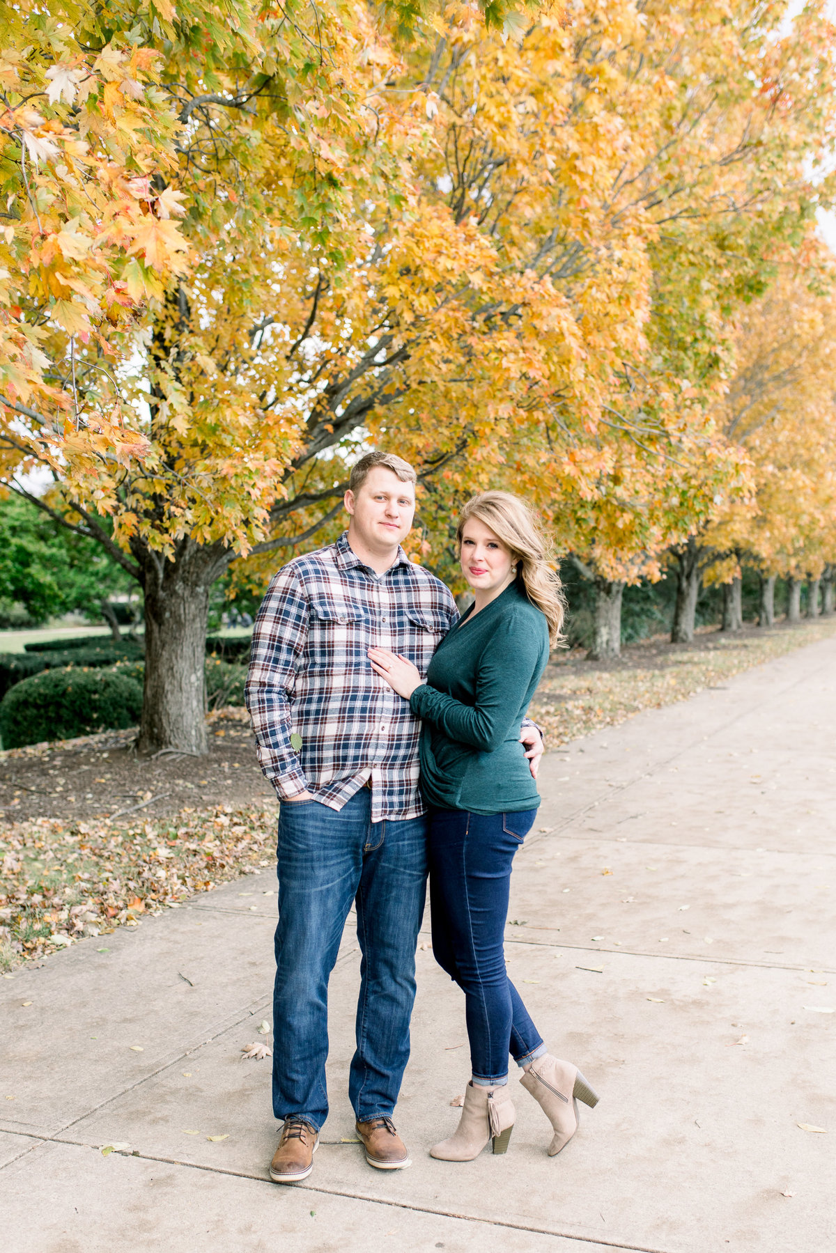 A couple standing together during their fall engagement session at Ault Park in Cincinnati, Ohio