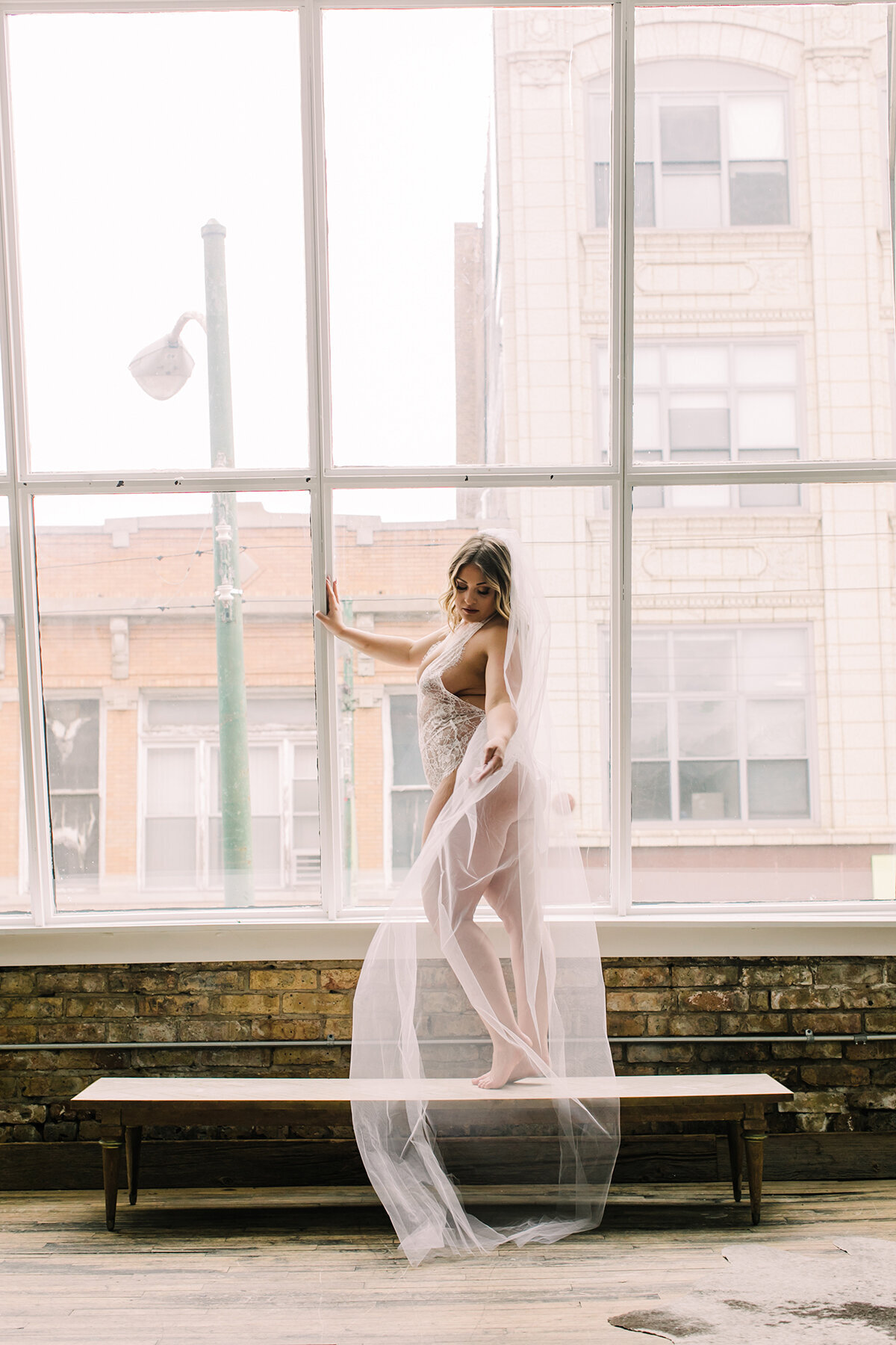 Bridal boudoir photo with wedding veil