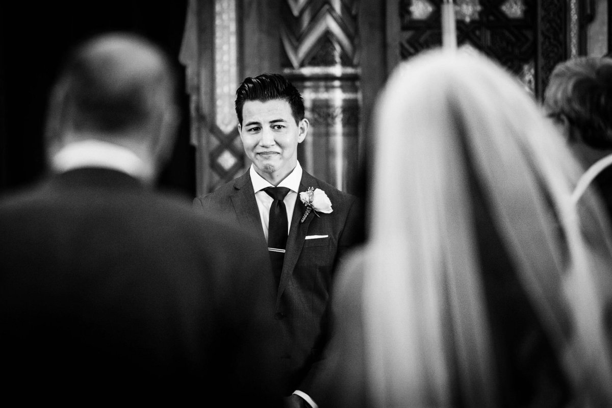 A groom reacts to seeing his bride at their Congress Plaza Hotel wedding.