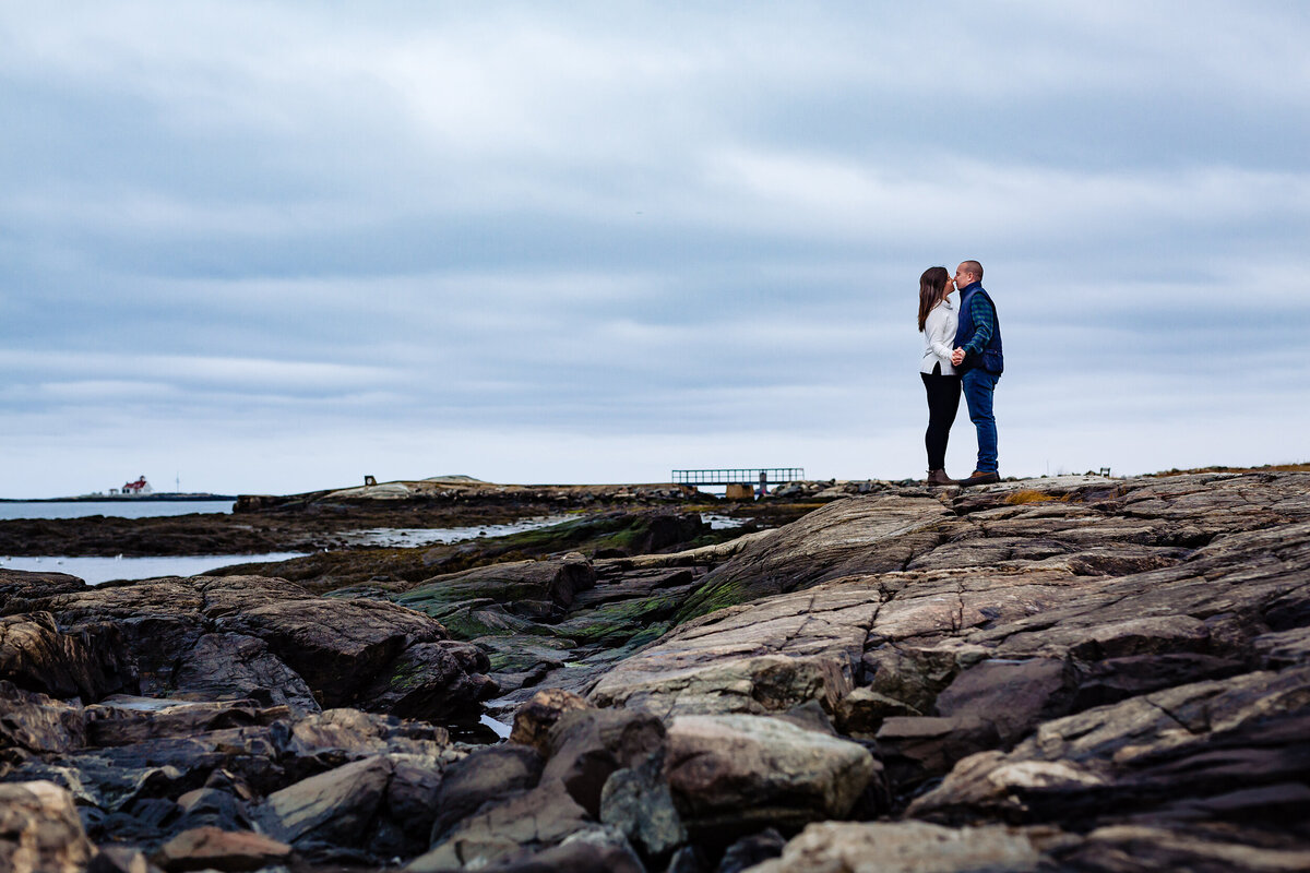 Great Island Common New Castle NH engagement session kissing out on the rocks