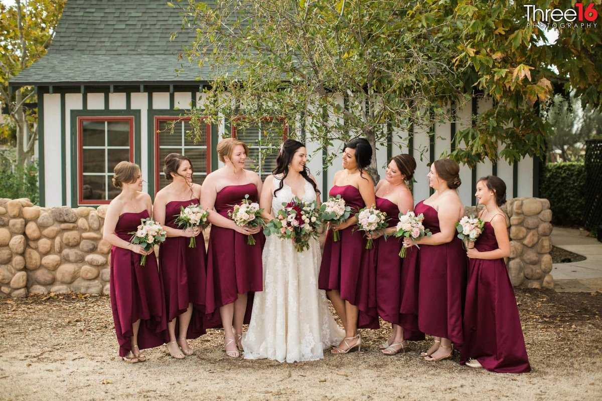 Bride and her Bridesmaids sharing a moment