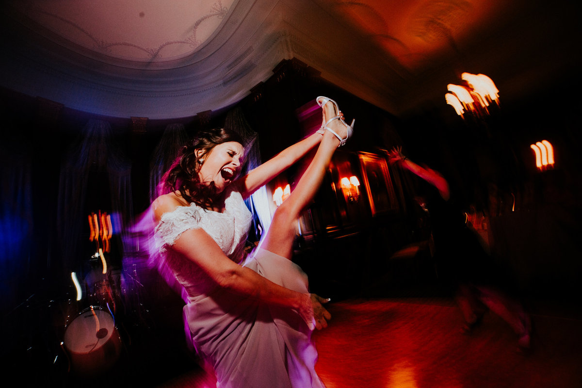 A colorful party with drinks and great music as the bride dances