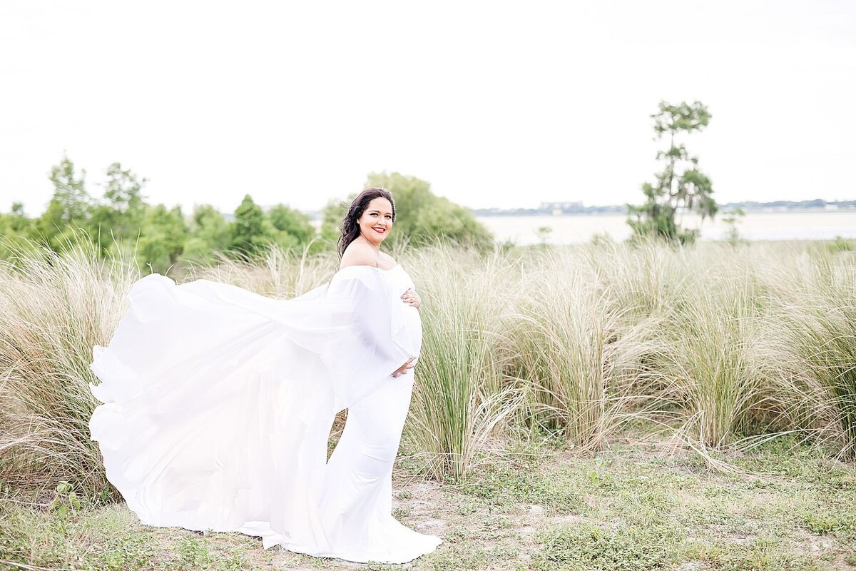 maternity photos in tall grass field