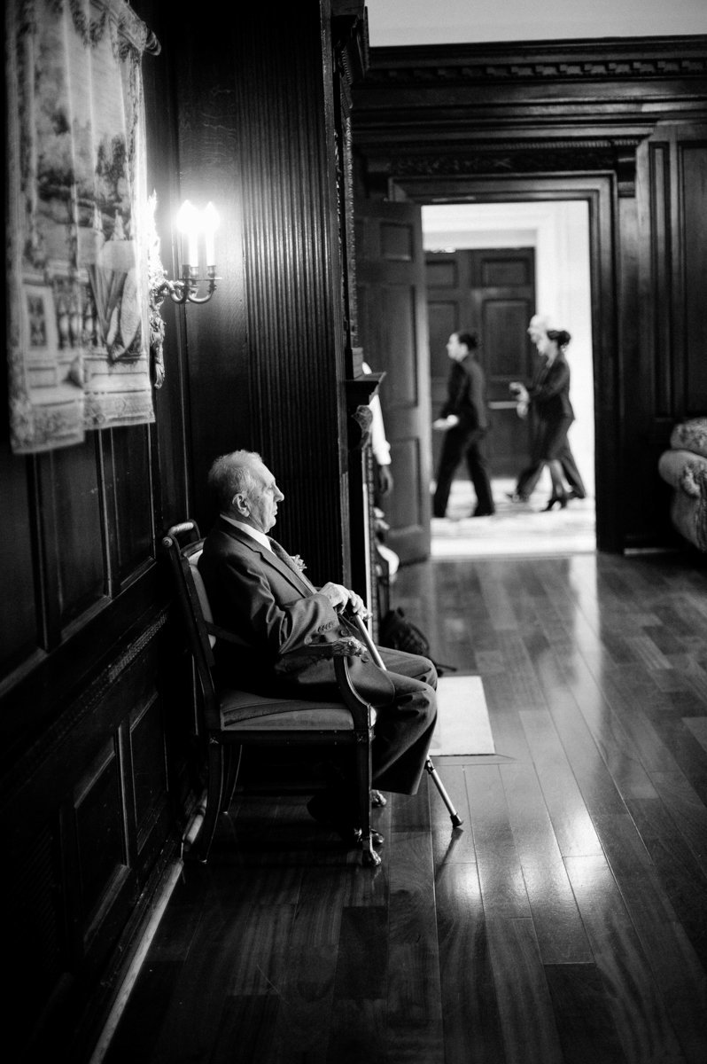 Grandpa waiting during a wedding in Long Island NY