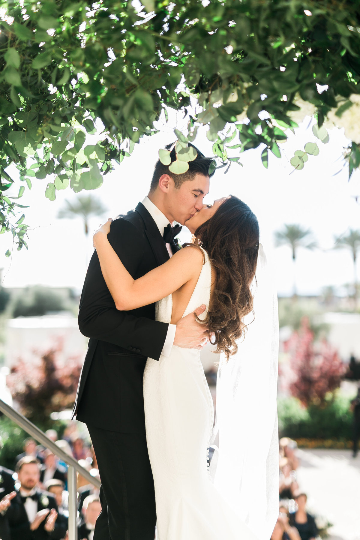 a photo of a bride and groom having their first kiss at their wedding ceremony at Green Valley Ranch Resort and Spa in Las Vegas