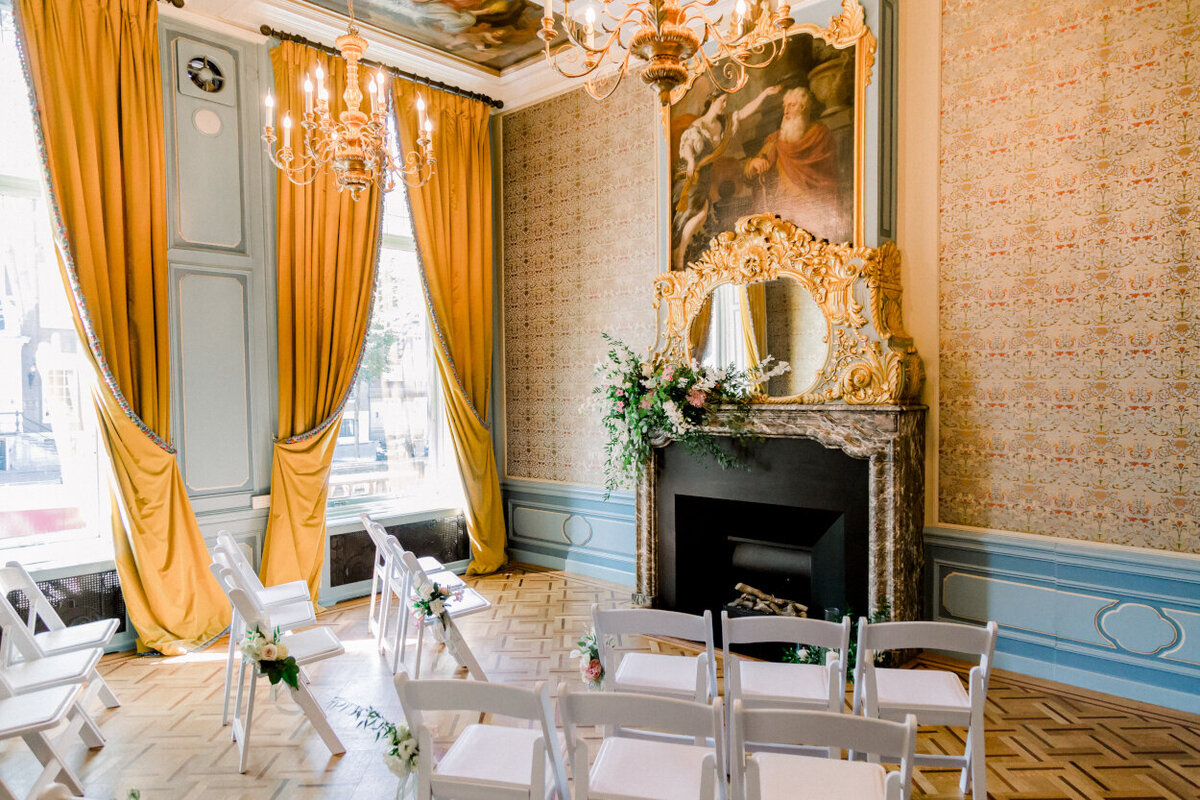Tassenmuseum's period room decorated with flowers and chairs for an intimate wedding photoshoot organized by Lovely & Planned