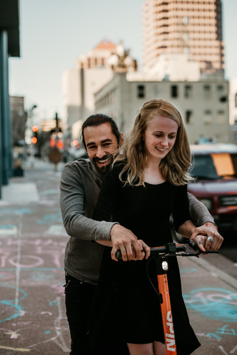 Couple riding rental scooter downtown Albuquerque