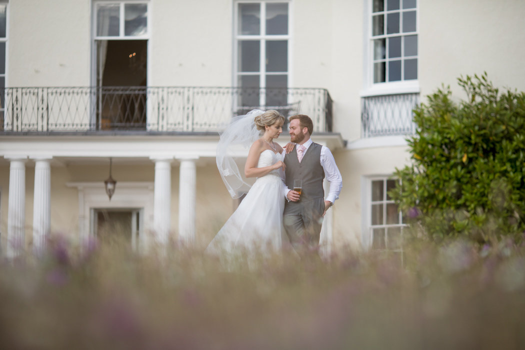 Couple on their wedding day at the front of Rockbeare Manor