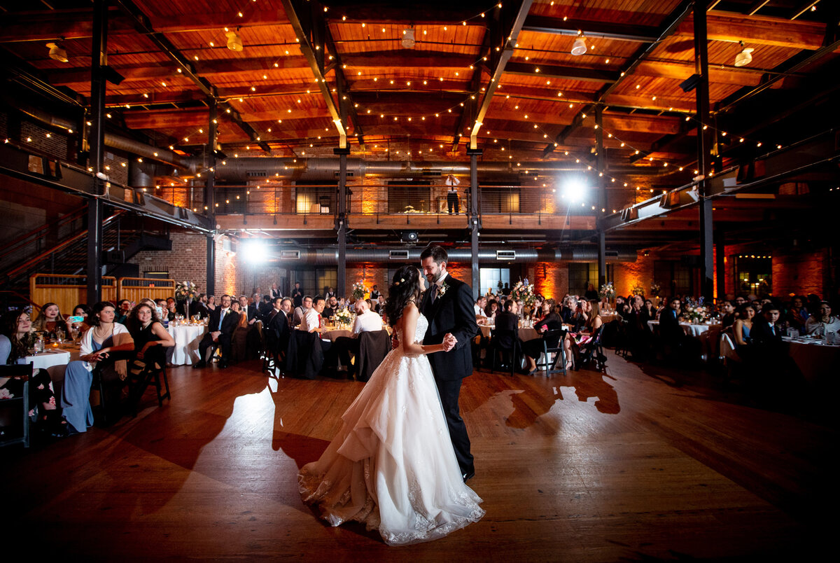 A bride and groom's first dance at Bay 7 in Durham.