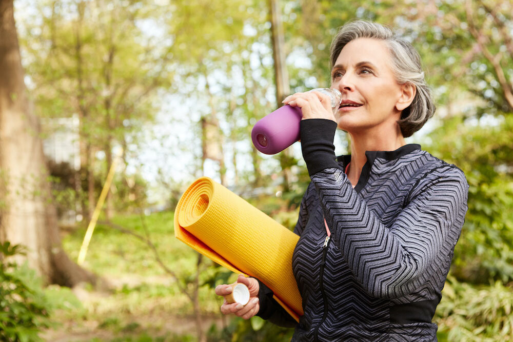 Older healthy athletic woman doing yoga and going for a walk