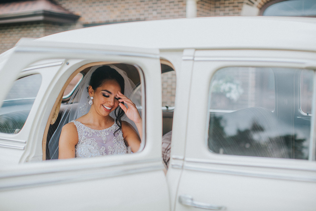 Bride in the backseat of classic car
