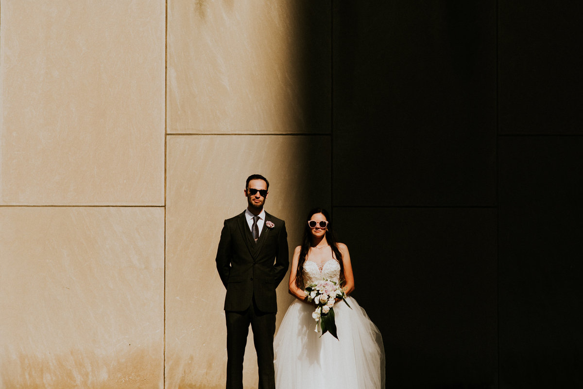 A bride and groom pose for a modern portrait at the unique venue