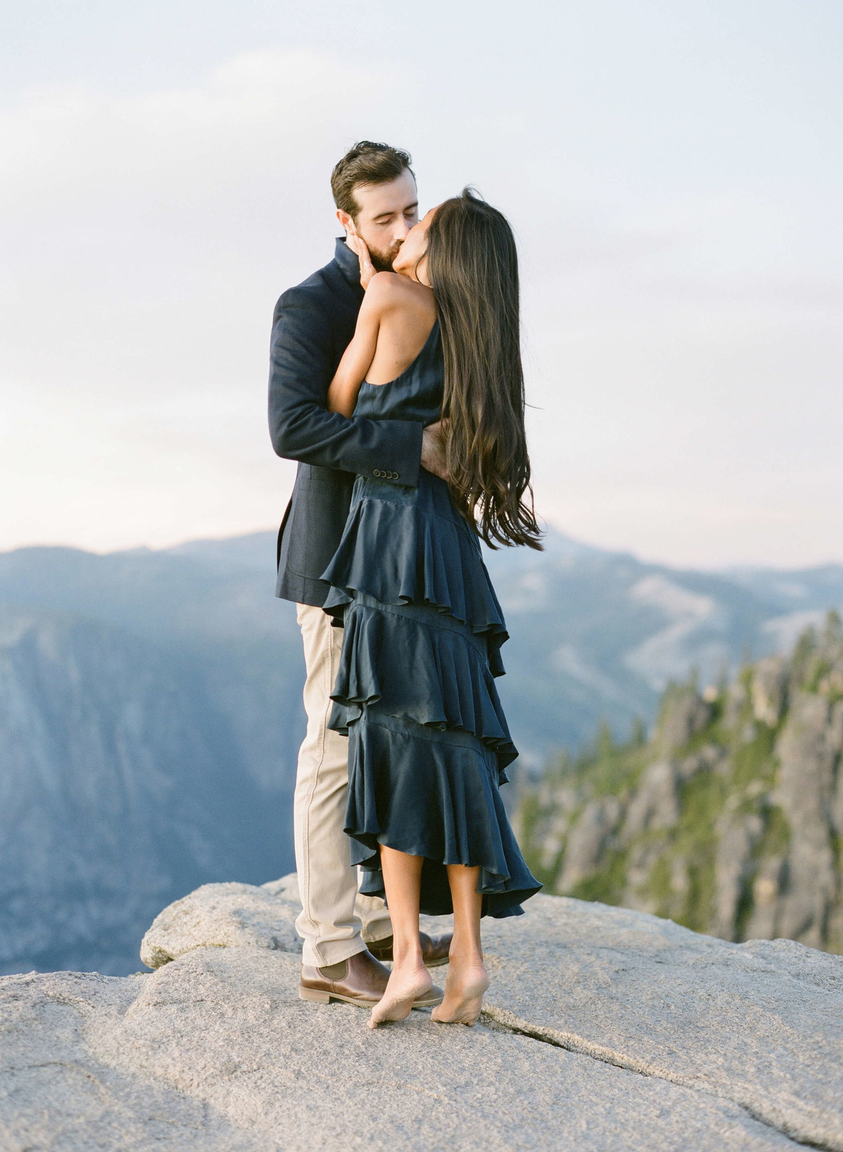 81-KTMerry-destination-engagement-Yosemite-mountain-kiss