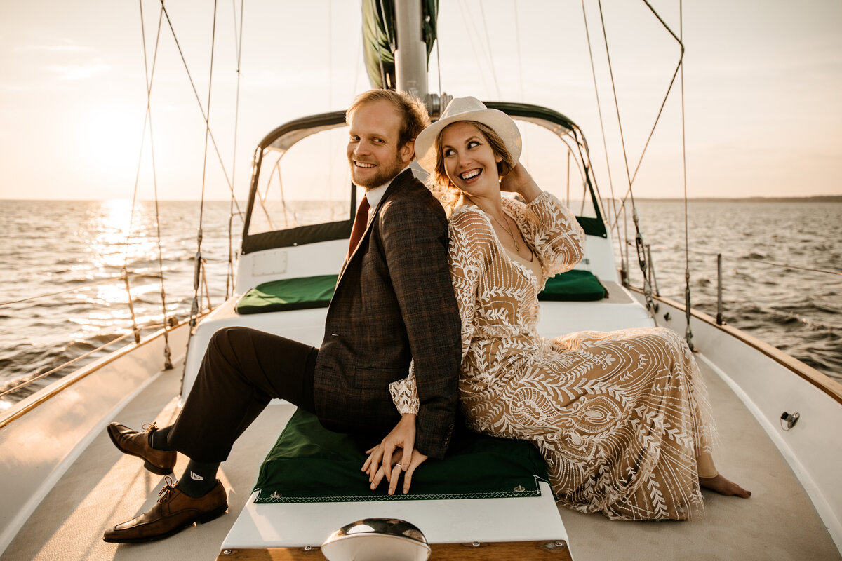 Bohemian sunset ocean sailboat elopement golden hour lace