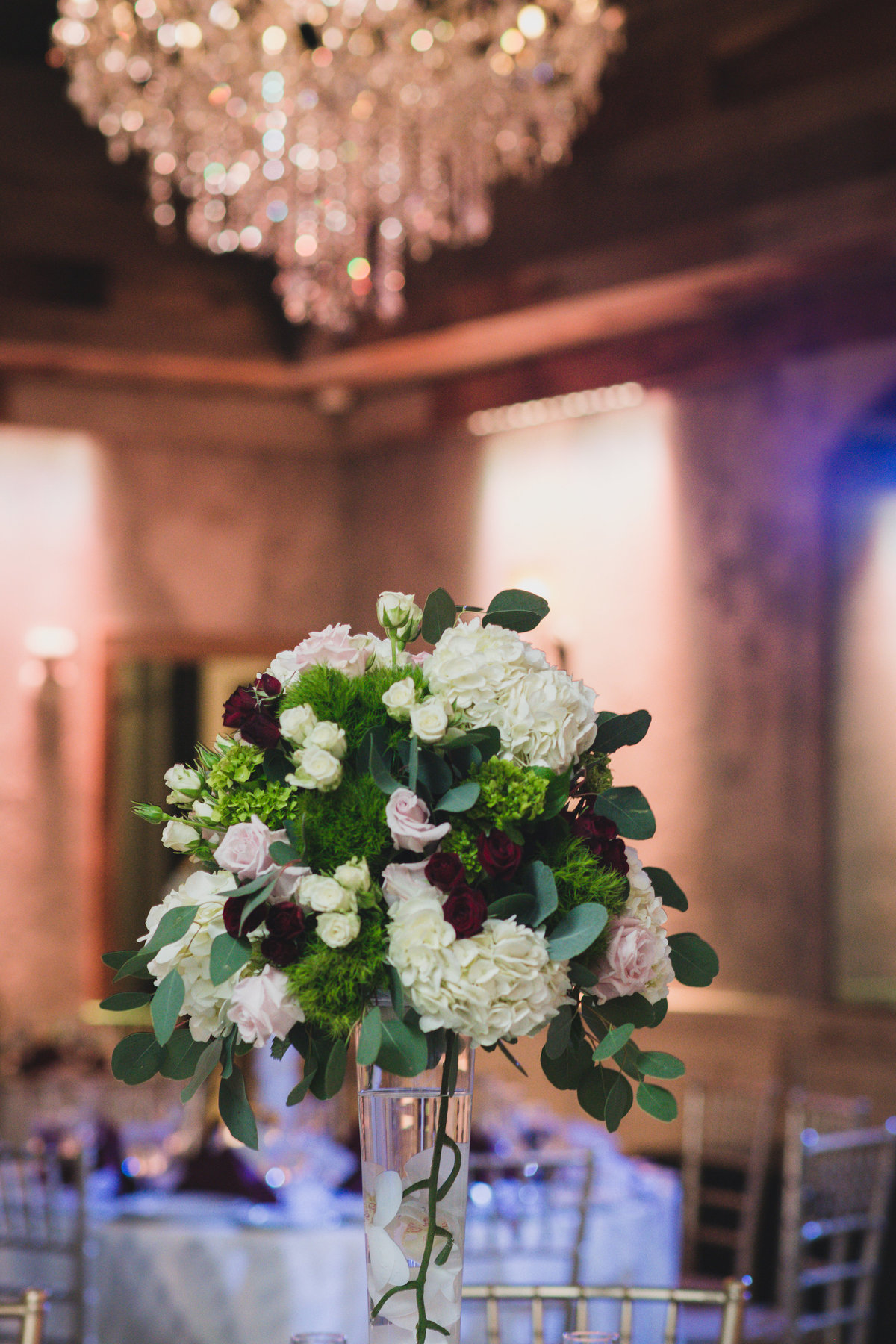 wedding photo of flower centerpiece at The Loft by Bridgeview