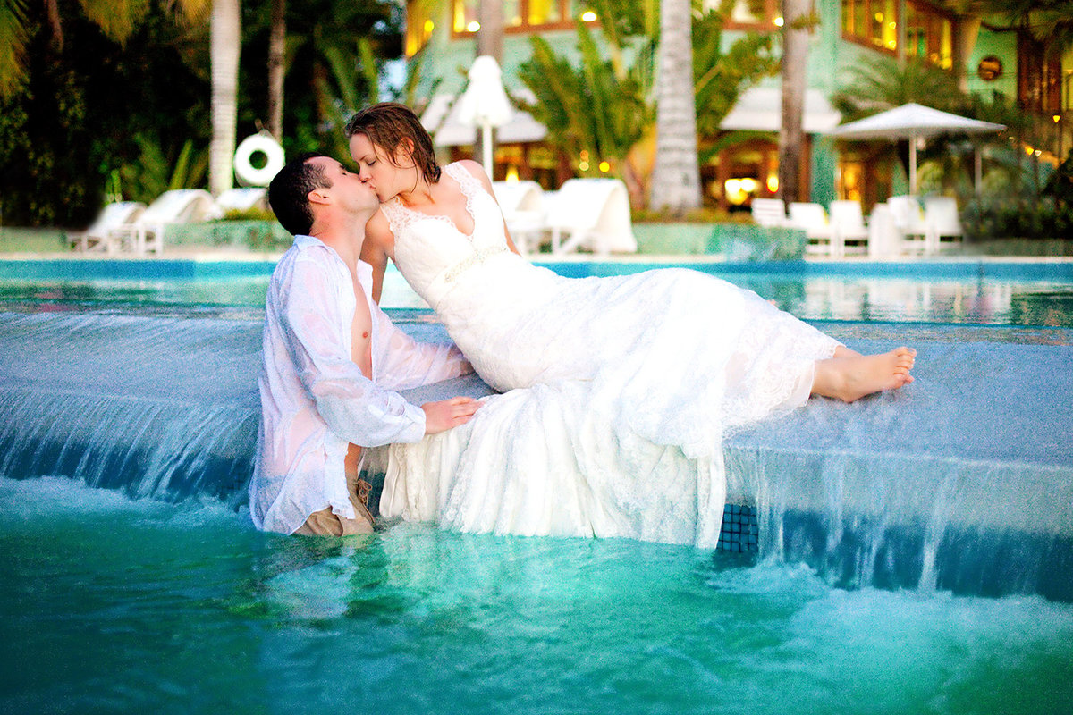 Destination wedding photos couple in pool trash the dress