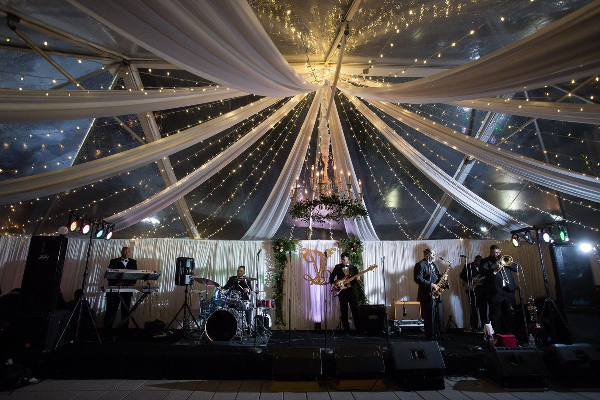 Drape and twinkle lights for tented wedding reception