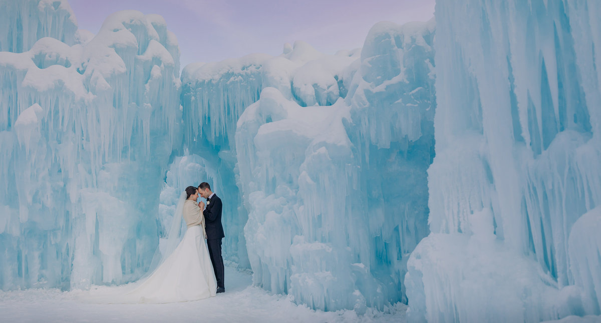 ice castles edmonton winter wedding newlyweds surrounded by ice