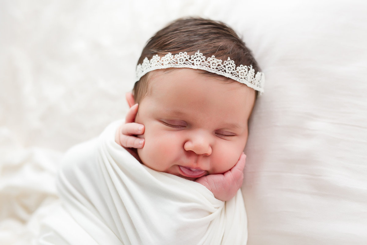 close up baby girl sleeping hands on face {Oakville Newborn Photographer}