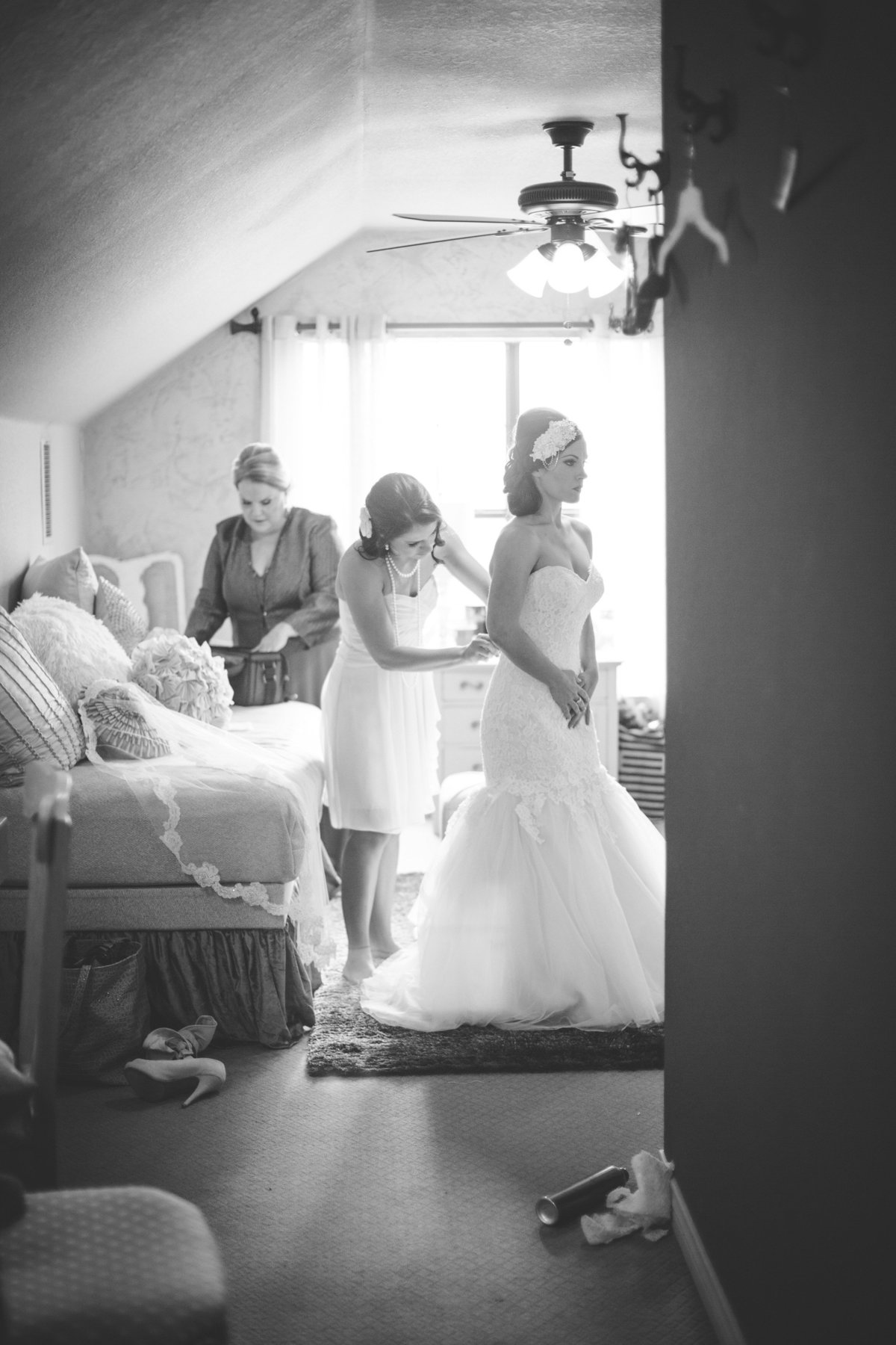 Bridesmaids get bride ready before wedding ceremony at Vista west ranch in Texas Hill Country wedding