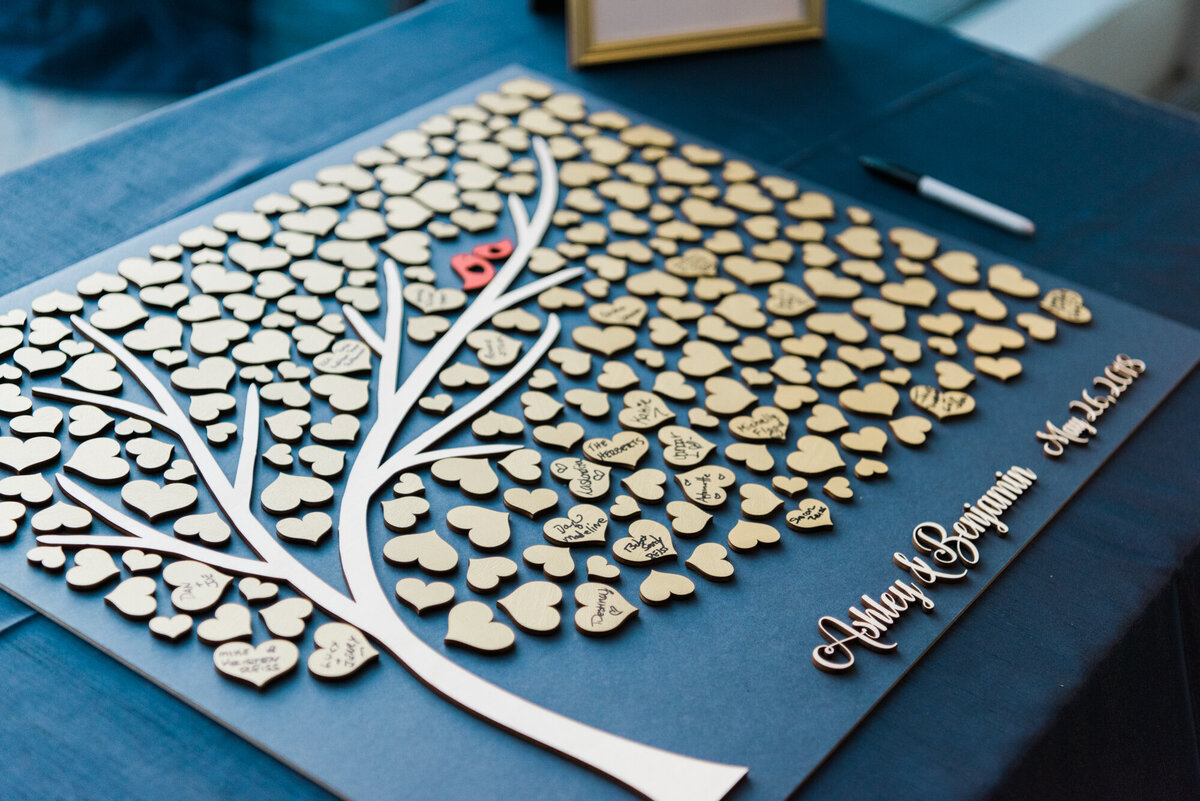 Wooden family tree guest book on table at destination wedding