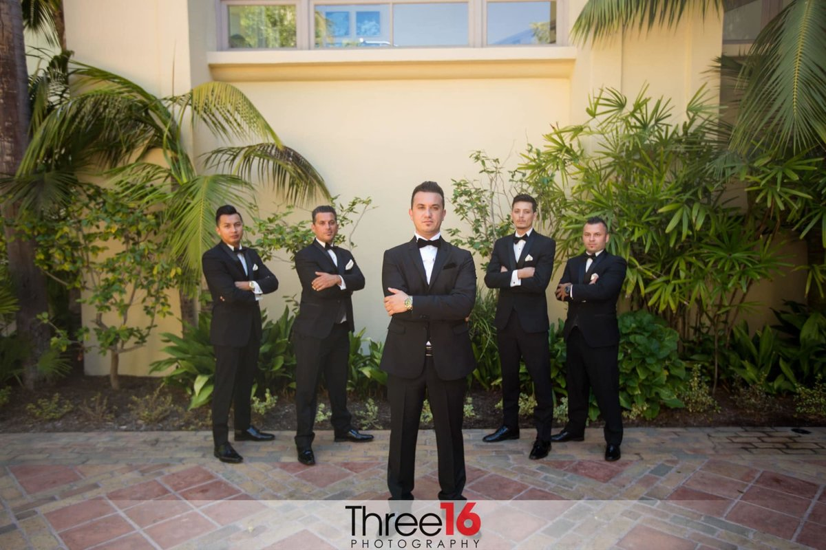 Groom and Groomsmen pose with arms crossed