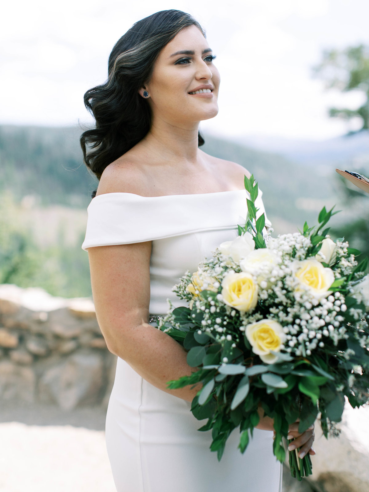 Bride holding her classic romantic bouquet at their Breckenridge wedding