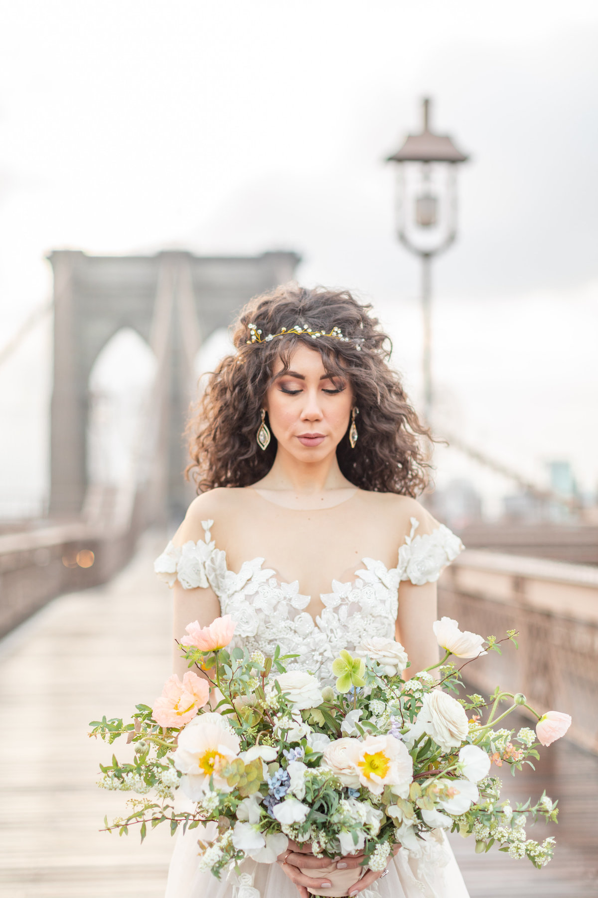 Bride at Brooklyn Bridge wedding with white and greenery bouquet