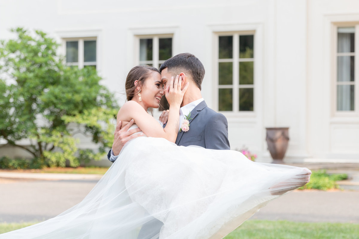 Groom sweeps bride off her feet at Wadsworth Mansion wedding in Connecticut