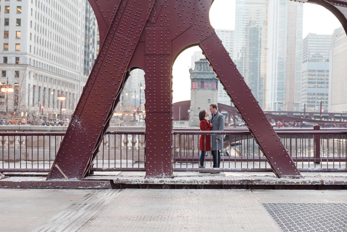 Couple embracing on bridge in downtown Chicago