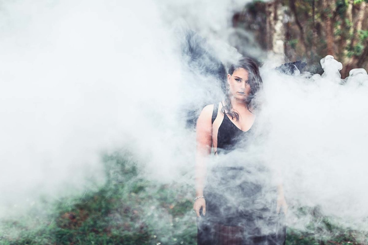 dark-angel-white-smoke-sexy-mysterious-photoshoot-inspo-model-breaking-tradition-jacksonville-fl