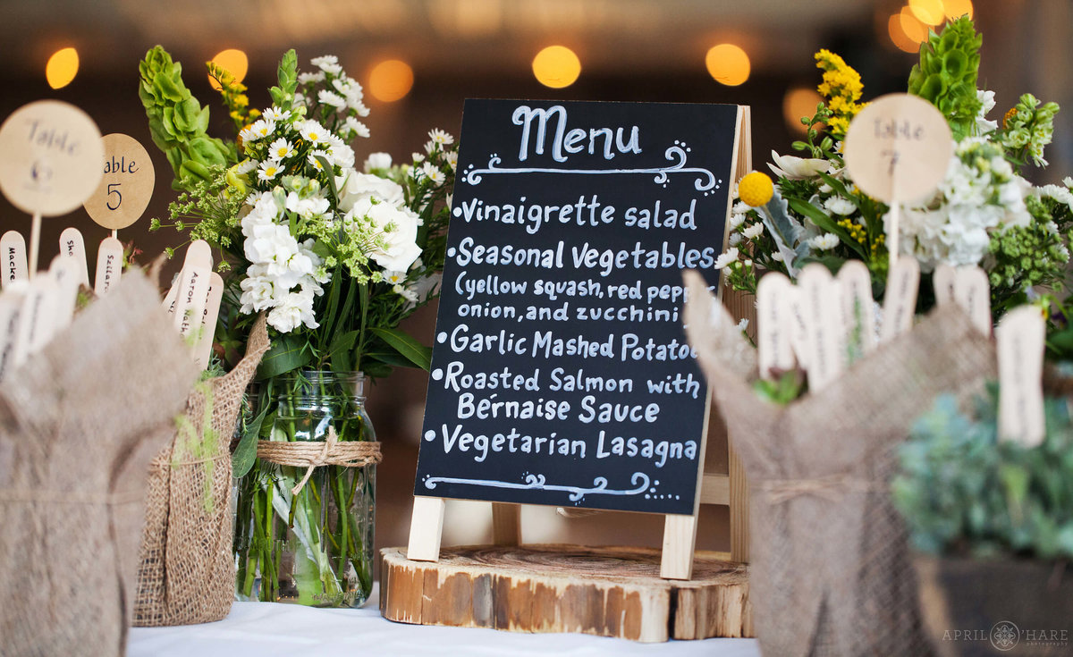Custom menu written on a chalkboard sign at Wedgewood Weddings on Boulder Creek in Colorado
