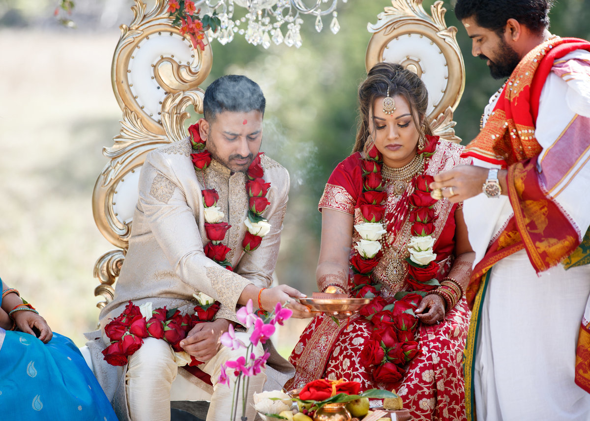 indian wedding photographer pecan springs ranch bride groom ceremony fire 10601 B Derecho Drive, Austin, TX 78737