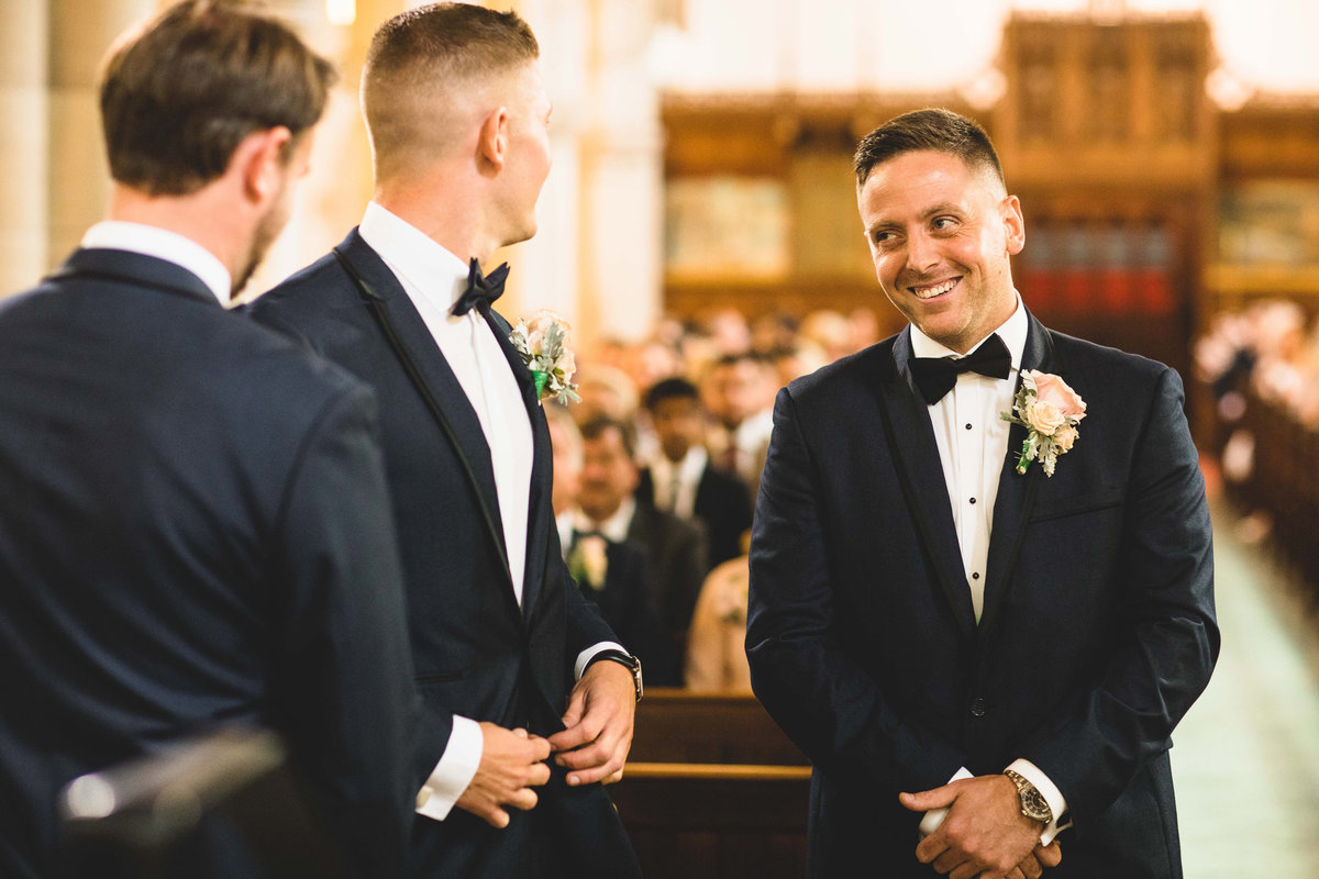 happy groom aisle