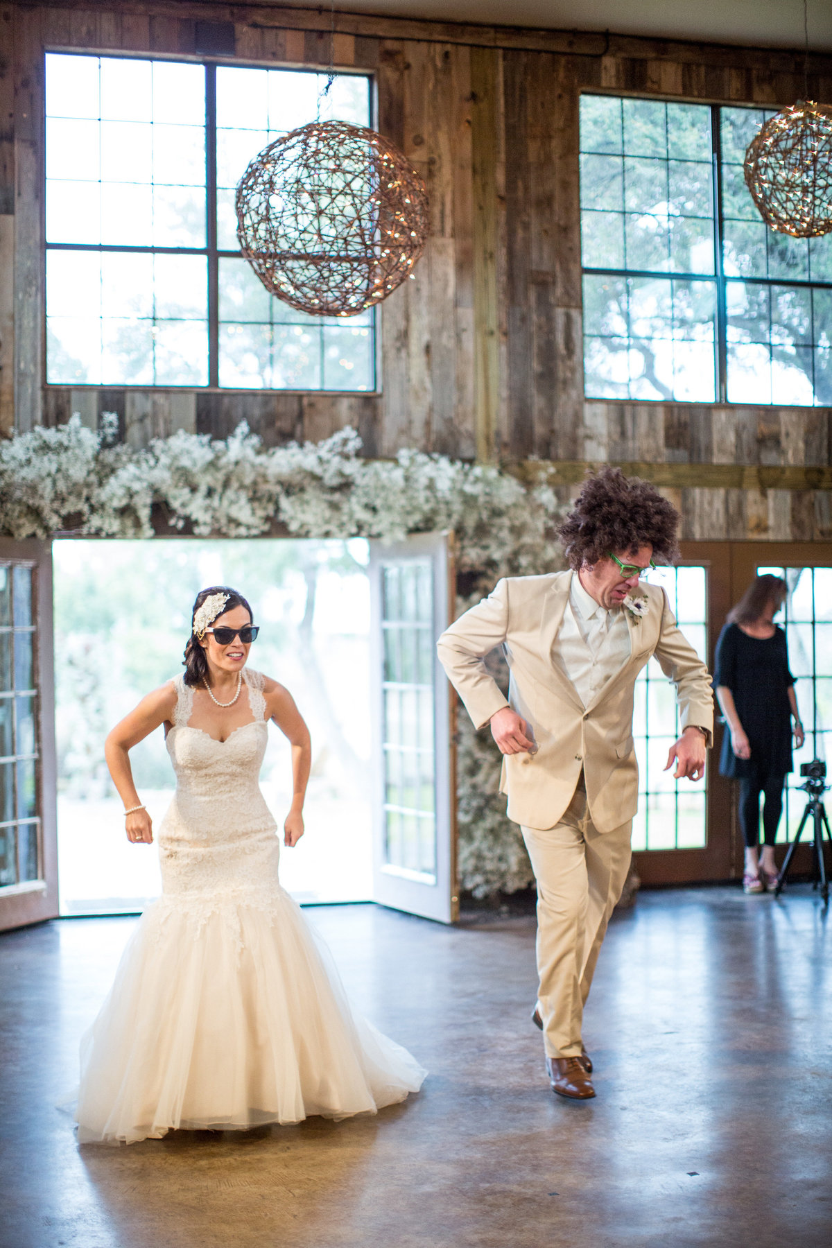 couple dancing to LMFAO for the wedding grand entrance at Vista West Ranch wedding venue