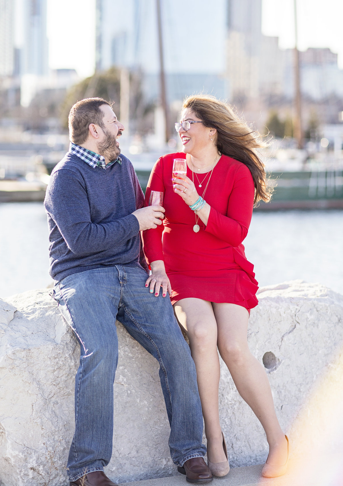 engaged couple with champagne milwaukee engagement photos