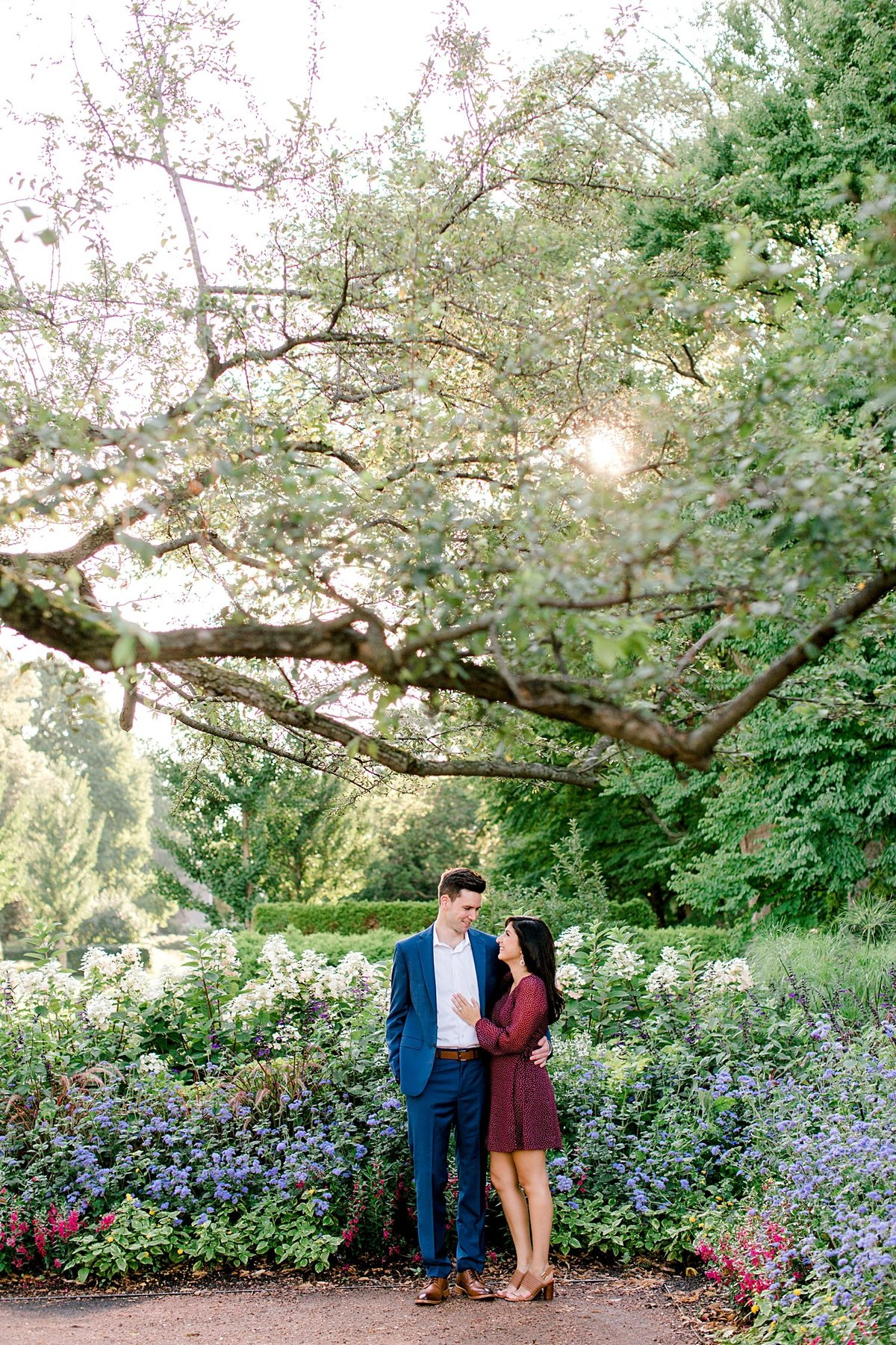 couple posing for engagement photos at morton arboretum
