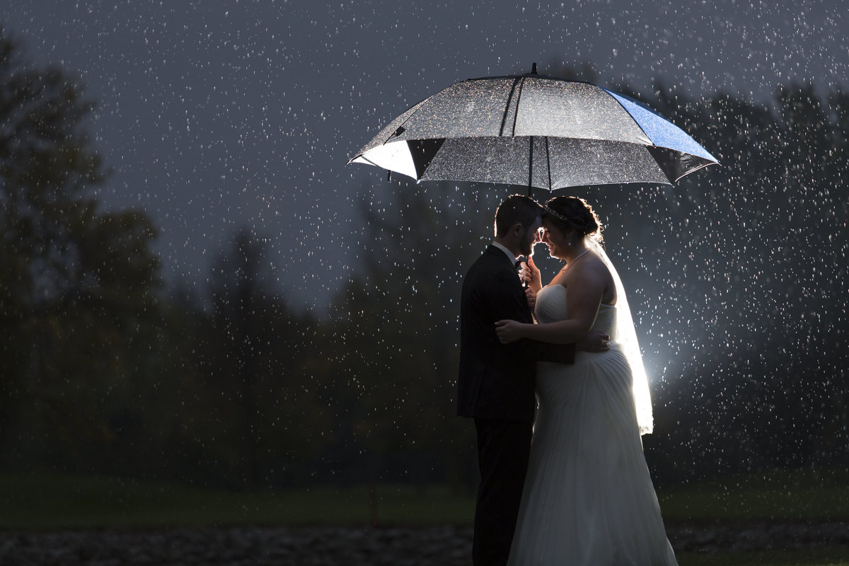 MadalynnMikeWedding390 bride groom rain umbrella wedding photography travel wedding photographer