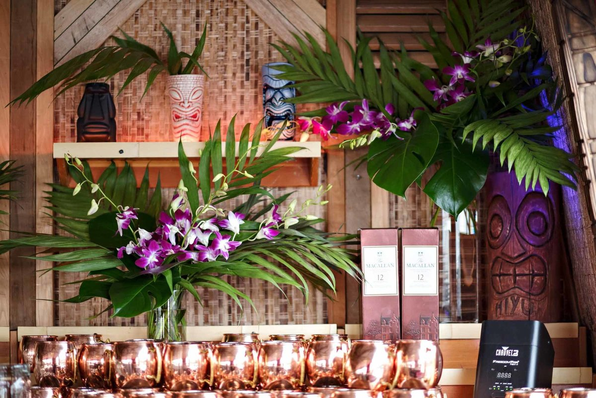 palm and orchid centerpiece for tiki bar
