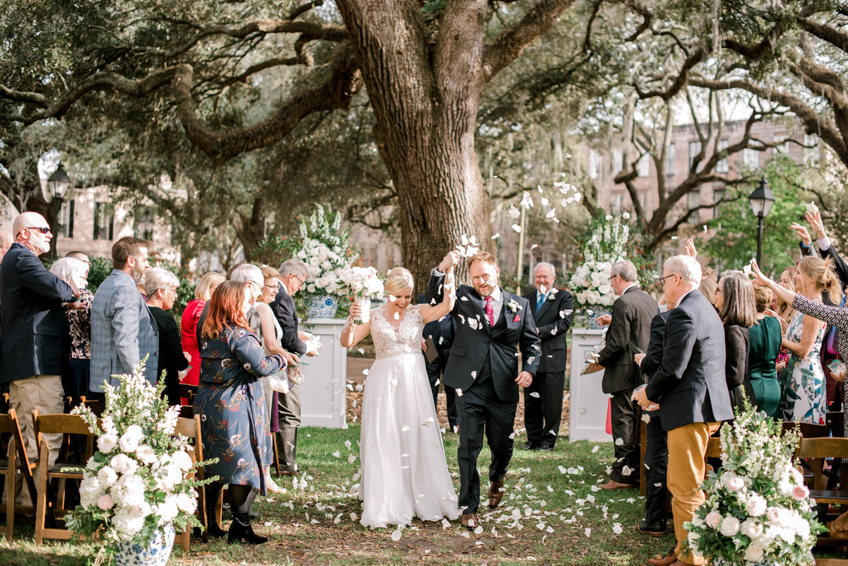 Bride and Groom walk down the aisle with rose petal ceremony exit