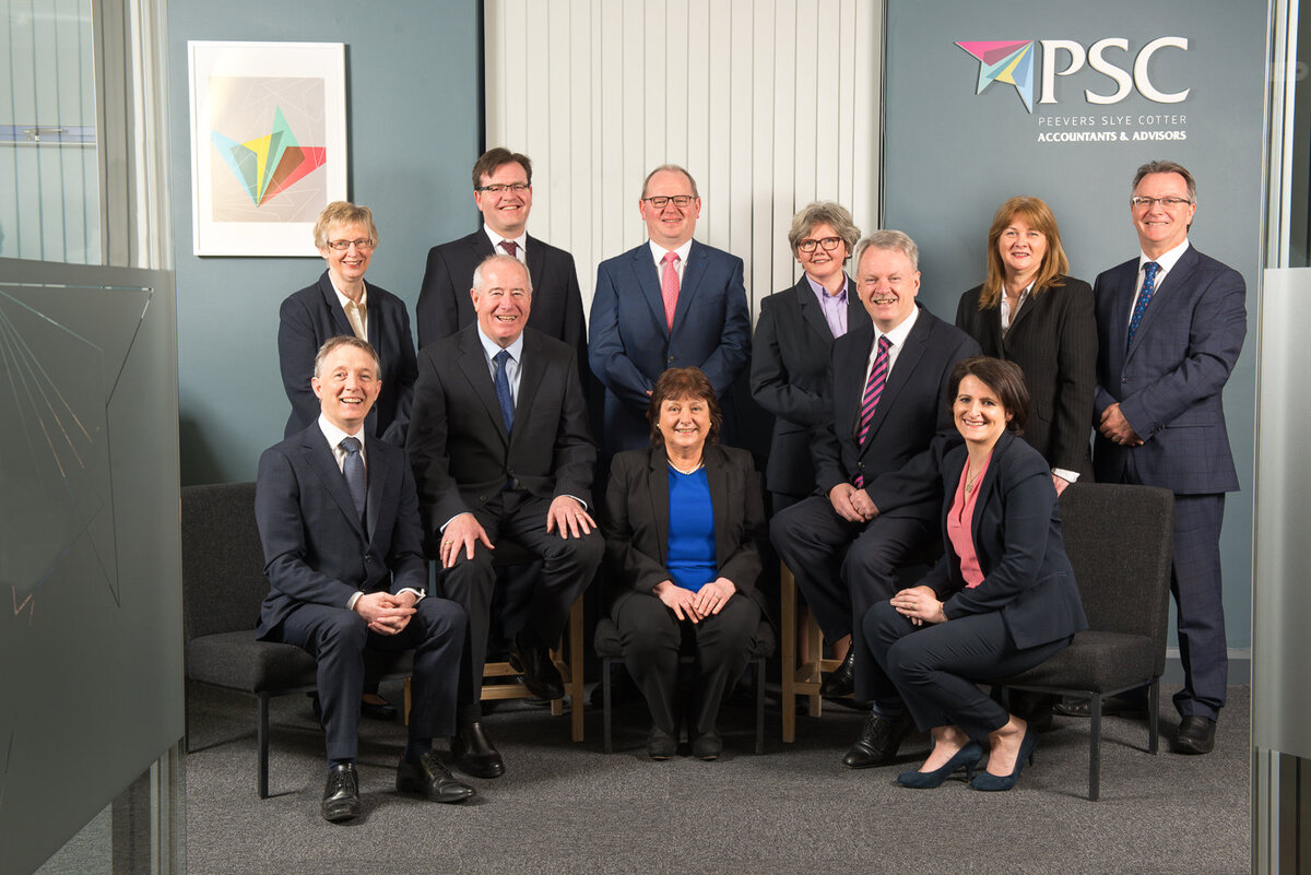 staff group at an accountancy firm wearing suits
