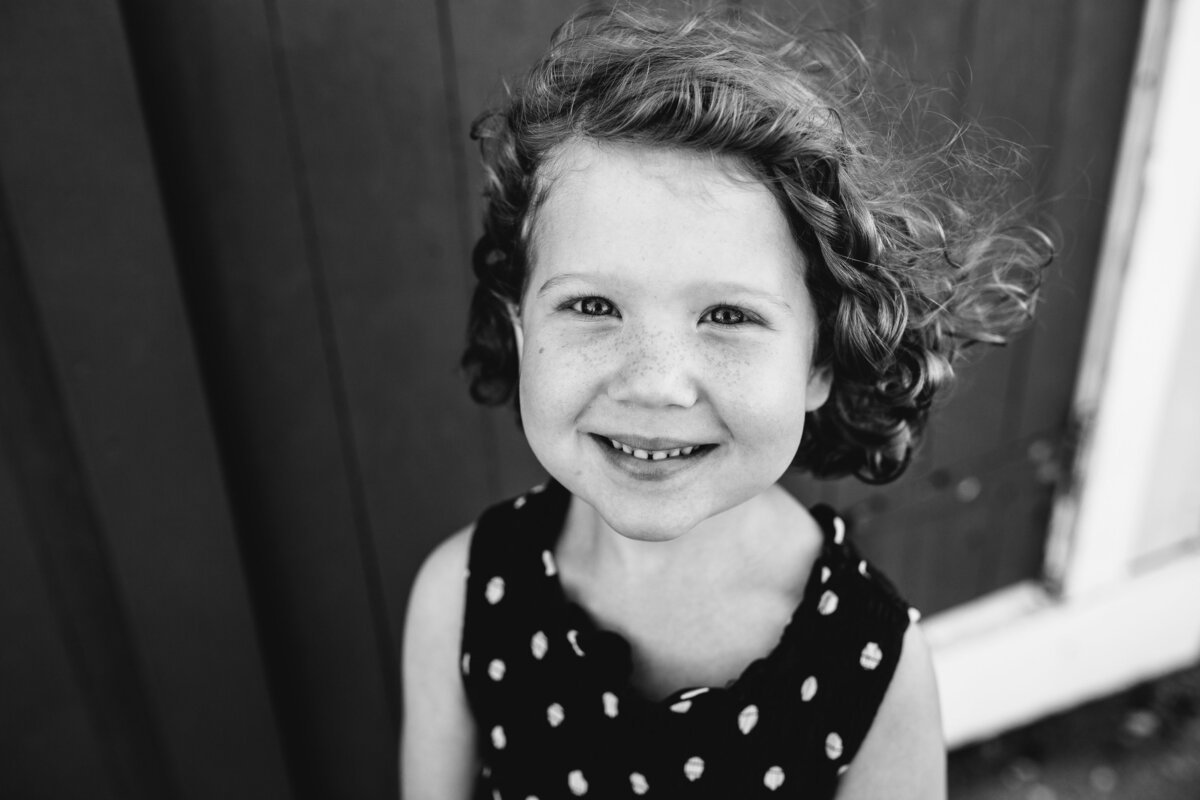 black and white girl with curls Melbourne family photography And So I Don't Forget Photography