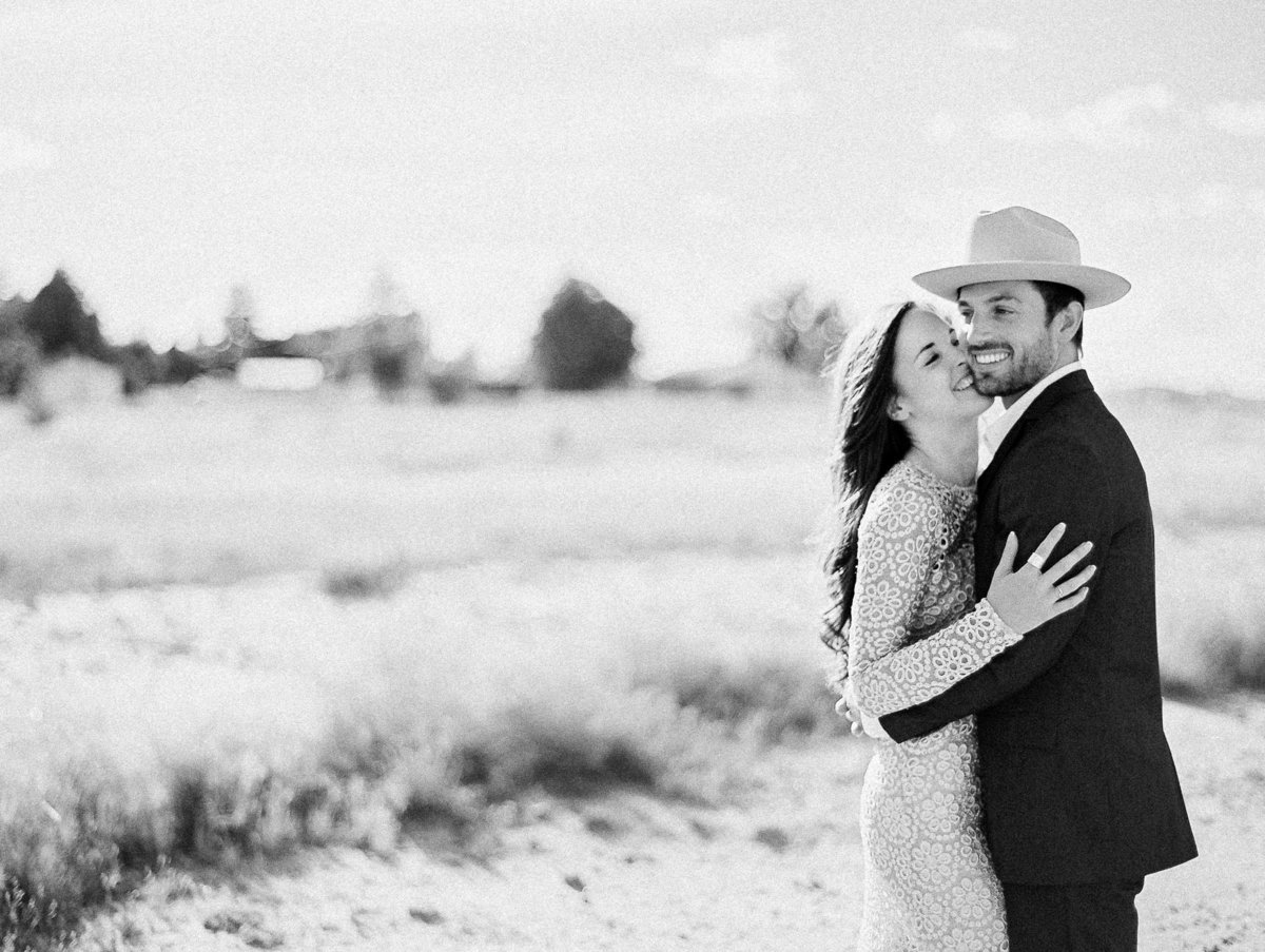 black and white couple marfa texas cowboy hat hugging