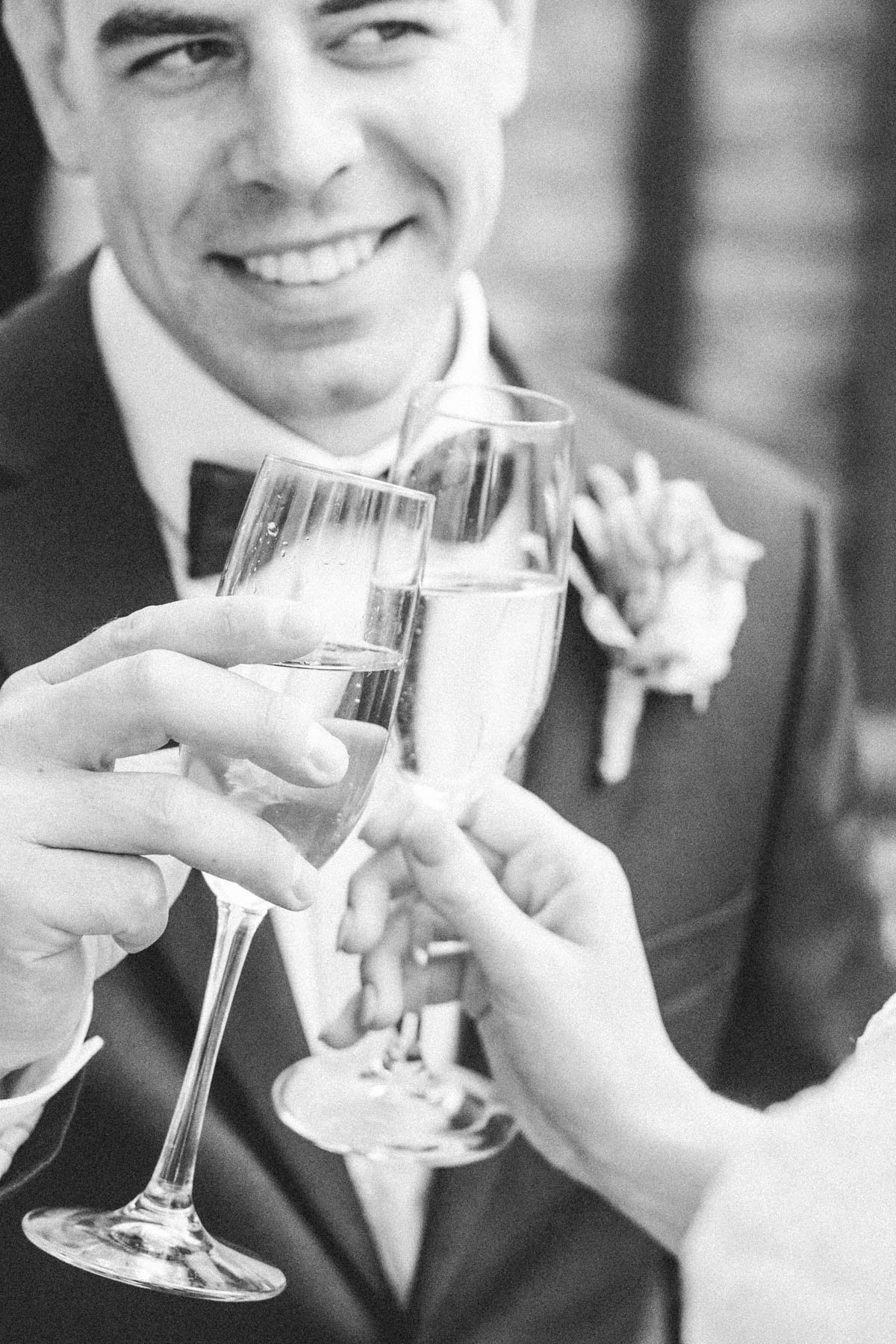 bride and groom toast champagne after wedding ceremony rochester minnesota