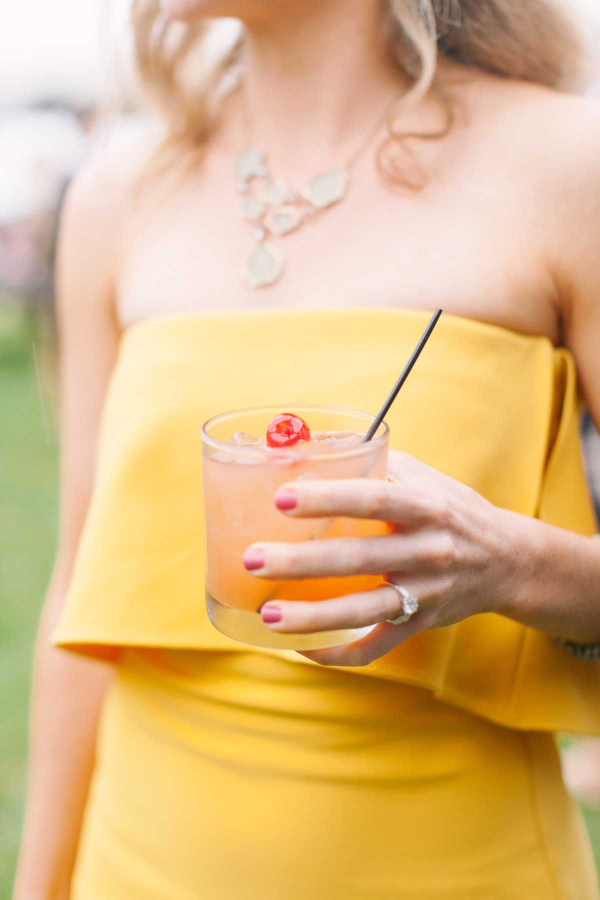 Guest in Yellow Dress holding Signature Cocktail at Charleston October Wedding
